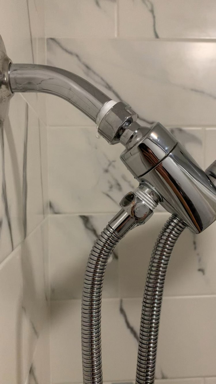 Had to replace shower head. Why is this leaking? How do I fix it? Should I not even worry about it?